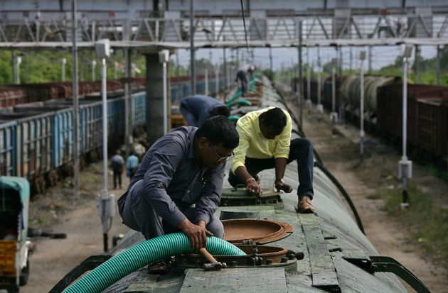 A worker fills a tanker train with water, which will be transported and supplied to drought-hit city...