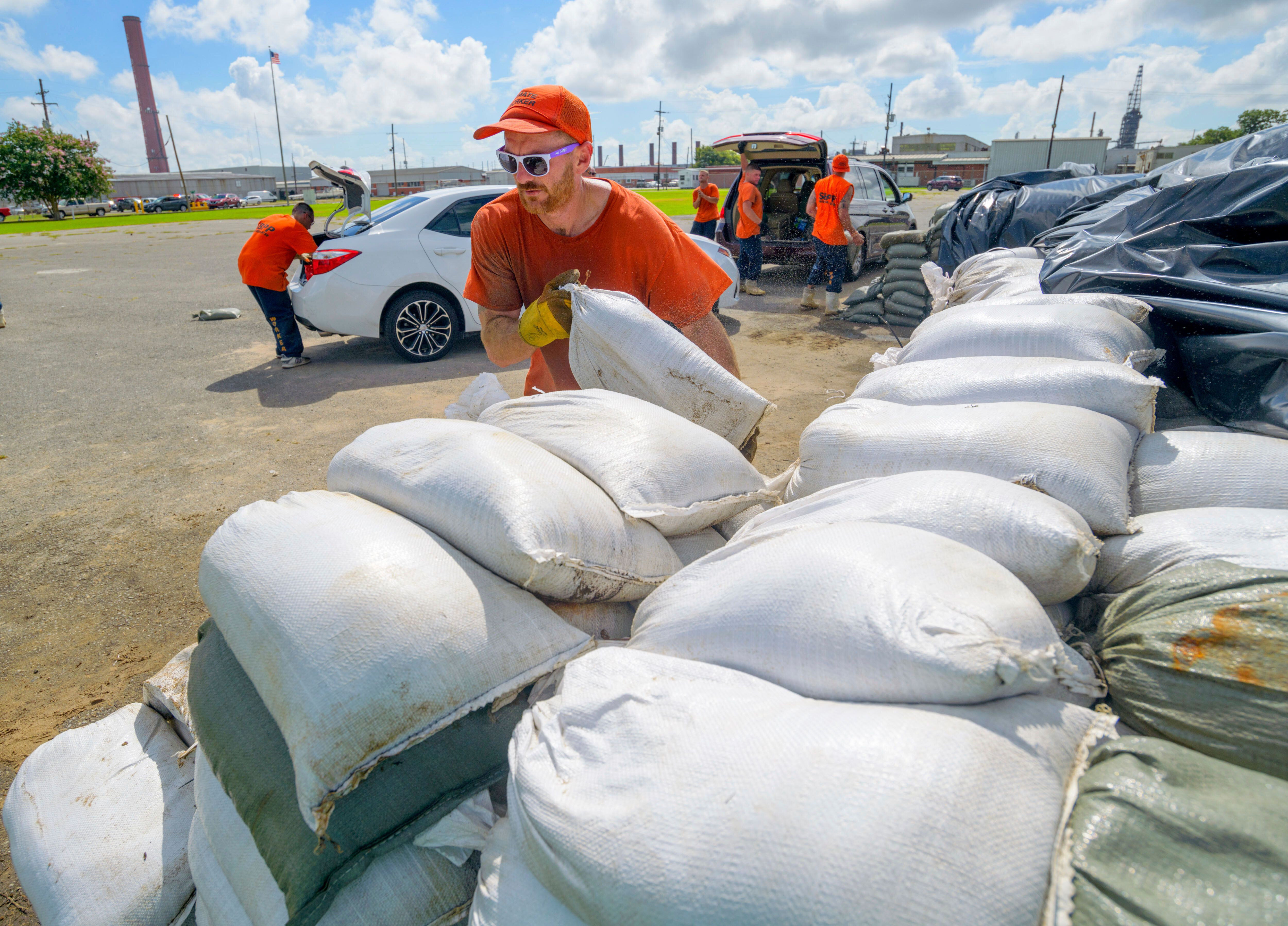 St. Bernard Parish Sheriff's Office inmate workers move free sandbags for residents in Chalmette, Louisiana, on Thursday. The Mississippi Emergency Management Agency is telling people in the southern part of the state to be prepared for heavy rain from Tropical Storm Barry.