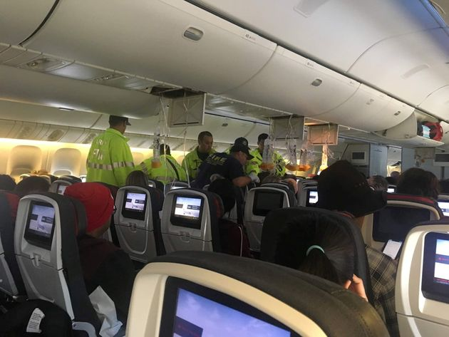 Emergency responders boarded the plane after it diverted to Hawaii two hours into the