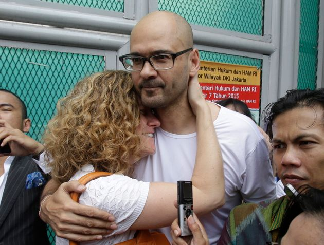 Canadian teacher Neil Bantleman hugs his wife, Tracy, in Indonesia on Aug. 14,