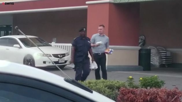 Lee Martin-Cramp, seen here walking with a police officer in Antigua, has been