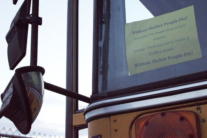 A sign in a school bus parked in one of Seattle's southern industrial zones. August 27, 2015.