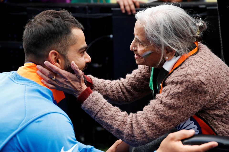 Charulata Patel, an Indian cricket fan, meets Virat Kohli after a World Cup cricket