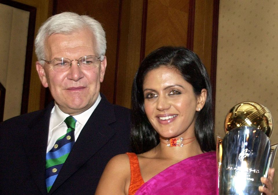 Mandira Bedi poses with the ICC Champions Trophy, as the CEO of ICC Malcolm Speed looks on in Bombay...