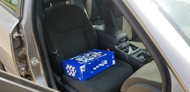 Ontario police found a two-year-old found sitting on a case of beer, as a makeshift booster