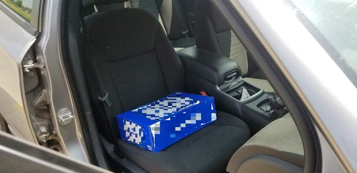 Ontario police found a two-year-old found sitting on a case of beer, as a makeshift booster seat.