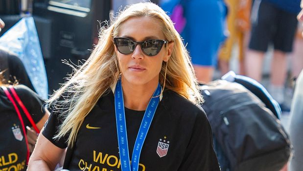 FILE - In this July 8, 2019 file photo, United States women's soccer team member Allie Long walks to a hotel Monday, July 8, 2019, in New York. The celebration was cut short for Long after she discovered someone had burglarized her hotel room in Los Angeles.  She tweeted on Thursday, July 11, that it happened after the team was honored at The ESPYS on Wednesday night.  (AP Photo/Corey Sipkin, File)