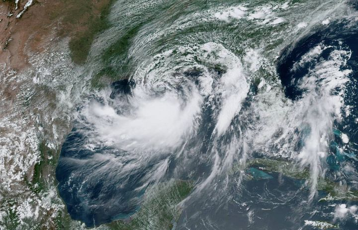 Tropical Storm Barry approaches the coast of Louisiana from the Gulf of Mexico in this July 12, 2019, satellite photo.