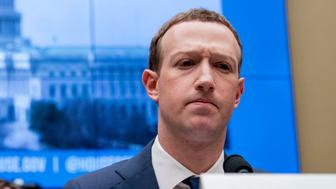 Facebook CEO Mark Zuckerberg pauses while testifying before a House Energy and Commerce hearing on Capitol Hill in Washington, Wednesday, April 11, 2018, about the use of Facebook data to target American voters in the 2016 election and data privacy. (AP Photo/Andrew Harnik)