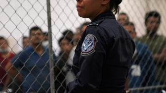 A U.S. Customs and Border Protection agent monitors single-adult male detainees at Border Patrol station in McAllen, Texas, U.S. July 12, 2019.  REUTERS/Veronica G. Cardenas