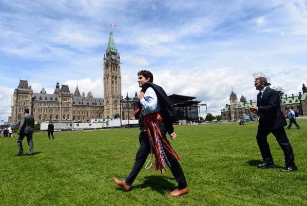 Prime Minister Justin Trudeau walks to Parliament following a National Indigenous Peoples Day announcement...