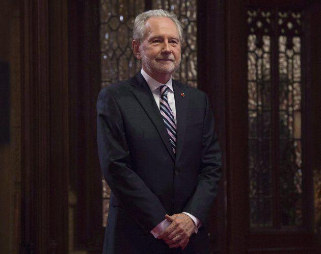 Sen. Peter Harder waits in the Senate lobby in Ottawa on Nov. 15,