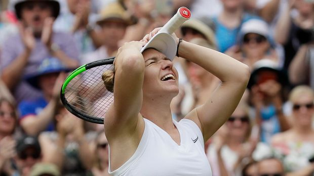 Romania's Simona Halep celebrates after defeating United States' Serena Williams during the women's singles final match on day twelve of the Wimbledon Tennis Championships in London, Saturday, July 13, 2019. (AP Photo/Kirsty Wigglesworth)