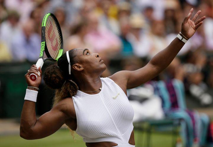 Serena Williams serves to Romania's Simona Halep during the women's singles final match. (AP Photo/Tim Ireland)