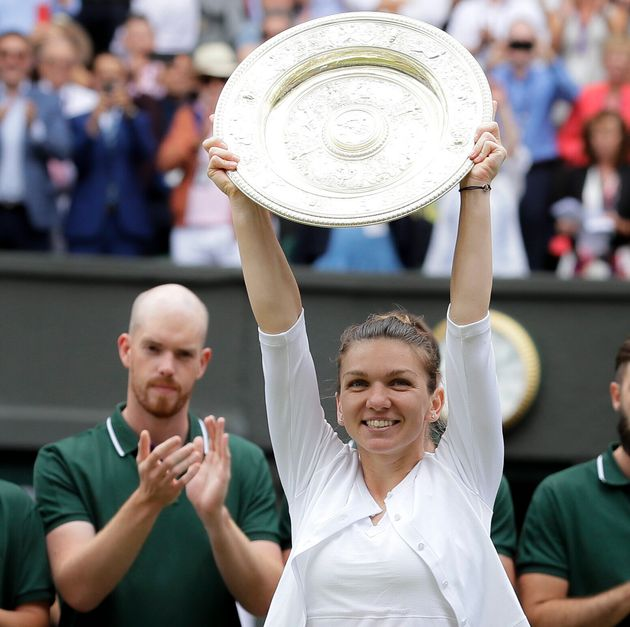 Simona Halep holds up her her trophy after the