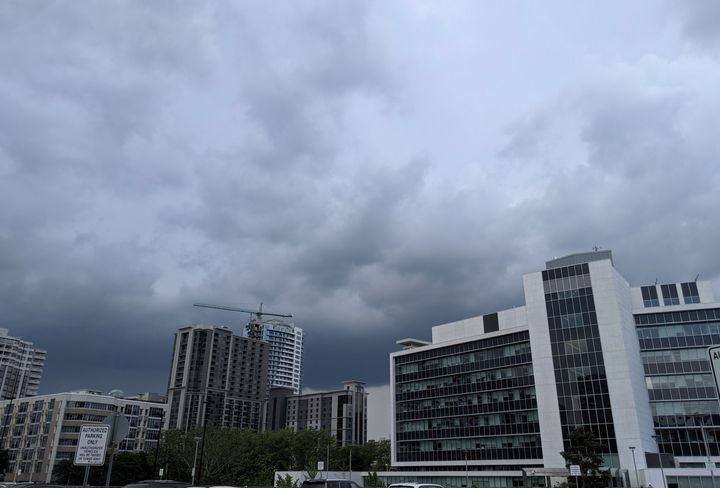 Storm clouds gather over Hamilton City Hall.