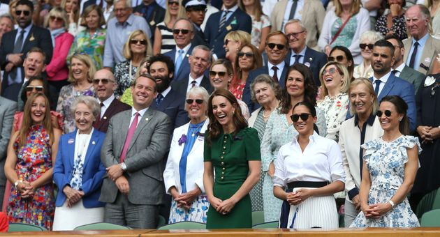 The Duchess of Cambridge and the Duchess of Sussex and Pippa Middleton Matthews share a laugh with others...