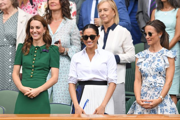 Retired tennis star Martina Navratilova stands behind the trio in the Royal