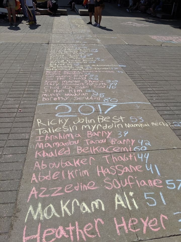 A list of people killed by fascists written in chalk on the forecourt of Hamilton City Hall on Saturday, July 13, 2019.