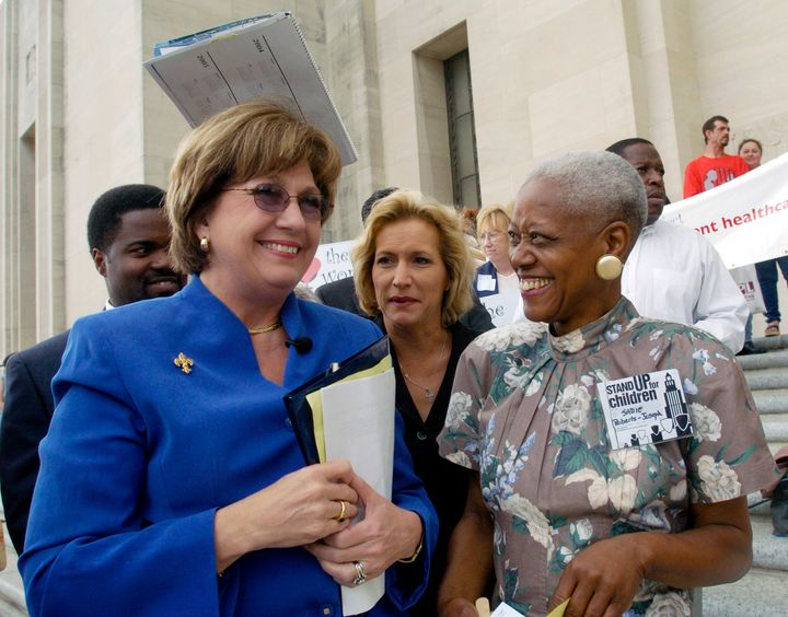 Sadie Roberts-Joseph (right), talks with Gov. Kathleen Blanco (left) before the start of the Stand Up for Children 2004 Rally