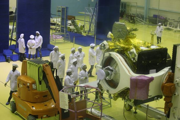 Scientists give finishing touches to the moon orbitter Chandrayaan 2 inside the clean room of the Indian...