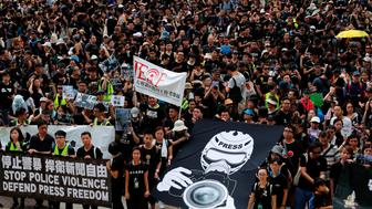 Journalists and supporters for press freedom wear black as they stage a silent march to Police Headquarters to denounce media treatment during protest against a proposed extradition bill, in Hong Kong, China  July 14, 2019. REUTERS/Tyrone Siu