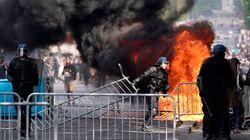 France: heurts entre gilets jaunes et policiers sur les Champs-Élysées en marge du défilé du 14