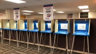 In this Sept. 20, 2018 photo, voting booths stand ready in downtown Minneapolis for the opening of early voting in Minnesota. A majority of Americans are concerned that a foreign government might interfere in some way in the 2020 presidential election, whether by tampering with election results, stealing information or by influencing candidates or voter opinion, a new poll shows.(AP Photo/Steve Karnowski)