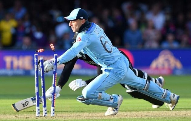 Jos Buttler runs out Martin Guptill in the super over to win the Cricket World