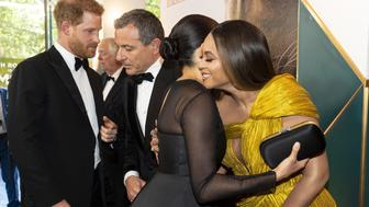 Britain's Prince Harry, Duke of Sussex (L) chats with Disney CEO Robert Iger as Britain's Meghan, Duchess of Sussex (2nd R) embraces US singer-songwriter Beyoncé (R) as they attend the European premiere of the film The Lion King in London on July 14, 2019. (Photo by Niklas HALLE'N / POOL / AFP)        (Photo credit should read NIKLAS HALLE'N/AFP/Getty Images)