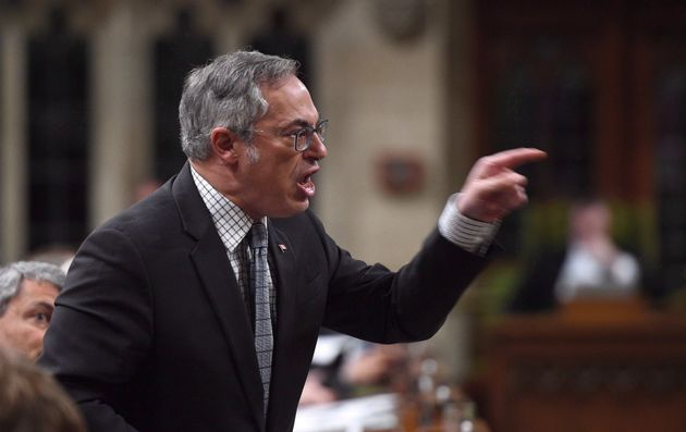 Tony Clement asks a question during question period in the House of Commons on April 13,