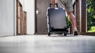 Men wear shorts that are dragging their luggage to accommodation to travel on holiday.