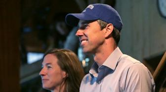 Democratic presidential candidate and former Texas Congressman Beto O'Rourke smiles as he stands with his wife Amy while being introduced at a gathering at a campus library at Colby-Sawyer College in New London, N.H., Friday, May 10, 2019. (AP Photo/Charles Krupa)
