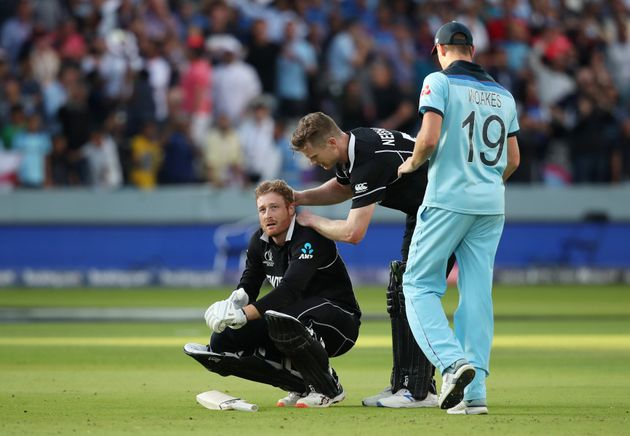 New Zealand's Martin Guptill is consoled by teammate James Neesham after England win the World