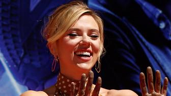 Actor Scarlett Johansson shows her hands after placing them in cement at a ceremony at the TCL Chinese Theatre in Hollywood, Los Angeles, California, U.S. April 23, 2019. REUTERS/Mario Anzuoni