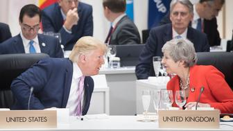 US President Donald Trump chats with British Prime Minister Theresa May at the first working session of the G20 Summit in Osaka, Japan. (Photo by Stefan Rousseau/PA Images via Getty Images)