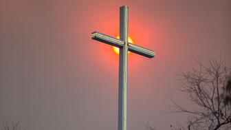VENTURA, CA - DECEMBER 07:  The sun shines through the smoke behind Bonsall Community Church in Bonsall, California on December 7, 2017 in Ventura, California.  A state of emergency was declared in San Diego County as the Lilac Fire threatened moe than a thousand structures. (Photo by Daniel Knighton/Getty Images)