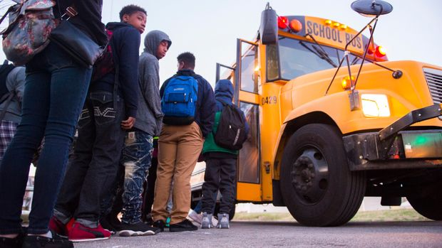 LOUISVILLE, KY - MARCH 2:  Students board a bus heading Atherton High School early on March, 2, 2017 in Louisville, Kentucky. The Kentucky GOP-led state House passed House Bill 151 that would require Jefferson County to return to neighborhood schooling, which could undo the county's longstanding desegregation efforts. (Michael Noble, Jr. for The Washington Post via Getty Images)