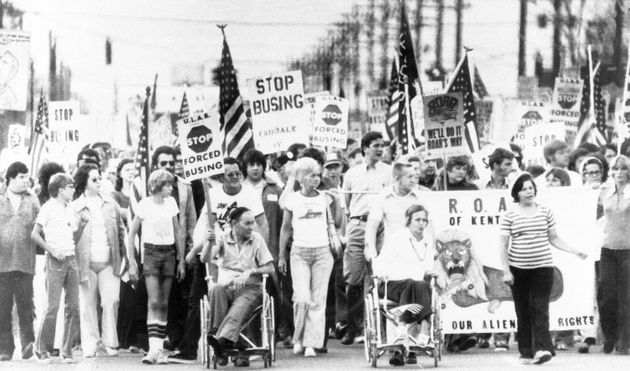 Protesters in southern Jefferson County, Kentucky, march against school desegregation on Aug. 31, 1976,...