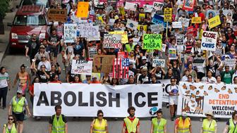 CHICAGO, ILLINOIS - JULY 13: Protesters march to offices of the U.S. Immigration and Customs Enforcement on July 13, 2019 in Chicago, Illinois.  The rally is calling for an end to criminalization, detention and deportation of migrants ahead of planned ICE raids expected to begin tomorrow.  (Photo by Nuccio DiNuzzo/Getty Images)