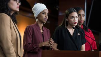 UNITED STATES - JULY 15: From left, Reps. Rashida Tlaib, D-Mich., Ilhan Omar, D-Minn., Alexandria Ocasio-Cortez, D-N.Y., and Ayanna Pressley, D-Mass., conduct a news conference in the Capitol Visitor Center responding to negative comments by President Trump that were directed at the freshman House Democrats on Monday, July 15, 2019. (Photo By Tom Williams/CQ Roll Call)