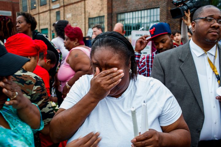 Shafonia Logan cries during a vigil for her husband, Eric Logan, who was shot and killed by a South Bend officer in an apartm
