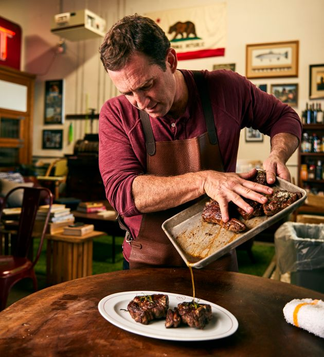 Chef Adam Perry Lang pours a post-marinade over seared