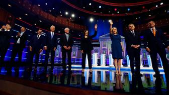 CORRECTS SPELLING OF GILLIBRAND'S FIRST NAME TO KIRSTEN, INSTEAD OF KRISTEN; CORRECTS BENNET'S TITLE TO SEN., INSTEAD OF FORMER SEN.Democratic presidential candidates from left, former Colorado Gov. John Hickenlooper, entrepreneur Andrew Yang, South Bend Mayor Pete Buttigieg, former Vice-President Joe Biden, Sen. Bernie Sanders, I-Vt., Sen. Kamala Harris, D-Calif., Sen. Kirsten Gillibrand, D-N.Y., Colorado Sen. Michael Bennet and Rep. Eric Swalwell, D-Calif., wave as they enter the stage for the second night of the Democratic primary debate hosted by NBC News at the Adrienne Arsht Center for the Performing Arts, Thursday, June 27, 2019, in Miami. (AP Photo/Brynn Anderson)