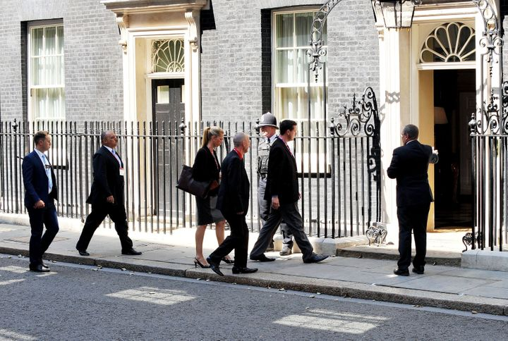 Families of Britons killed in the downing of the plane visit Downing Street for a meeting with David Cameron who was prime minister at the time.