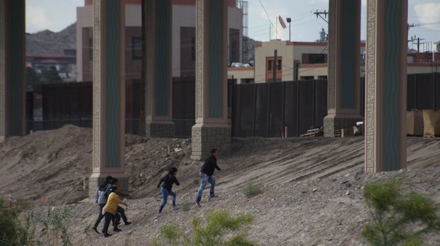 Migrants Cross The Rio Bravo To Surrender To The Border Patrol On The Border Ciudad Juarez El Paso Texas, on 8 May 2019. They cross approximately 700 migrants per day and are detained by the border patrol. The majority are families with their children in their arms. (Photo by David Peinado/NurPhoto via Getty Images)