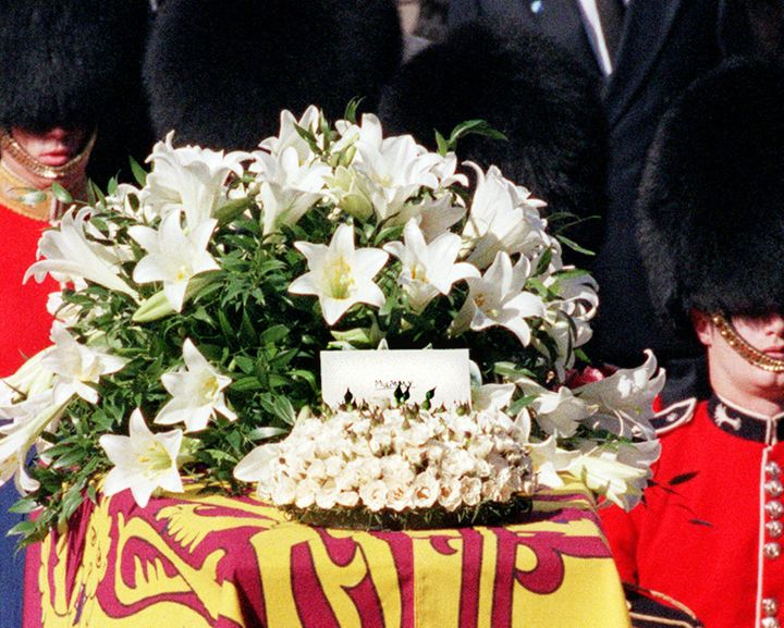 "During Princess Diana's funeral at Westminster Abbey, <a href=""https://www.eonline.com/news/35134/farewell-mummy-princess-diana-s-funeral"" target=""_blank"" rel=""noopener noreferrer"">a message from young Prince Harry</a>&nbsp;sat atop the flowers on&nbsp;her&nbsp;coffin. The envelope simply read, ""Mummy."""