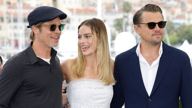 "Brad Pitt, Margot Robbie and Leonardo DiCaprio at the photo call for ""Once Upon A Time"" during the 72nd Cannes Film Festival at the Palais des Festivals on May 22, 2019 in Cannes, France. (Photo by: P. Lehman) (Photo credit should read P. Lehman / Barcroft Media via Getty Images)"