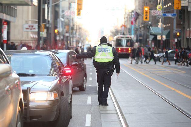 Toronto Police officer pulls over drivers and issues a ticket on Nov. 20,