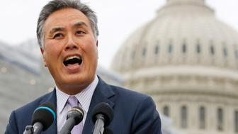 House Veterans' Affairs Chairman Mark Takano, D-Calif., speaks about veteran suicide prevention, Monday April 29, 2019, at the House Triangle on Capitol Hill in Washington. (AP Photo/Jacquelyn Martin)